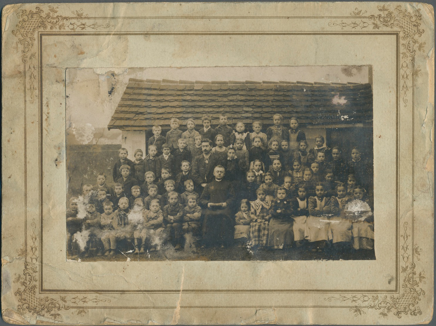 Adolf Hitler at the age of 6 (4th from the left on the top row) with his classmates in Fischlham, Austria-Hungary