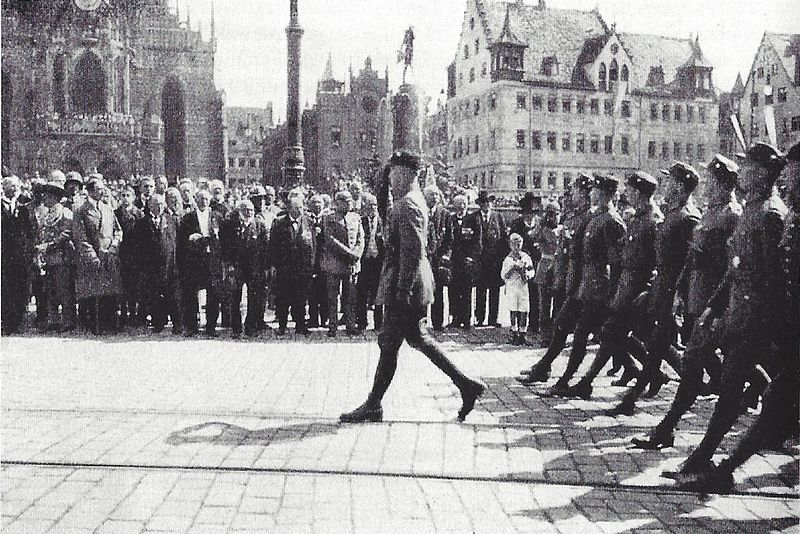 Adolf Hitler with Bavarian party members watch the SA parade