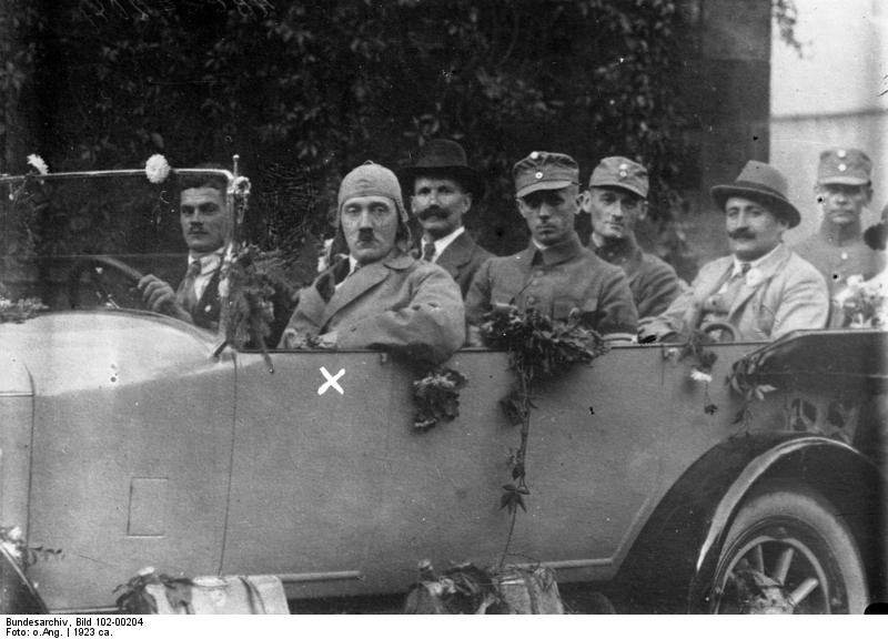 Early party members pose with Hitler in his car at the Deutscher Tag in Hof