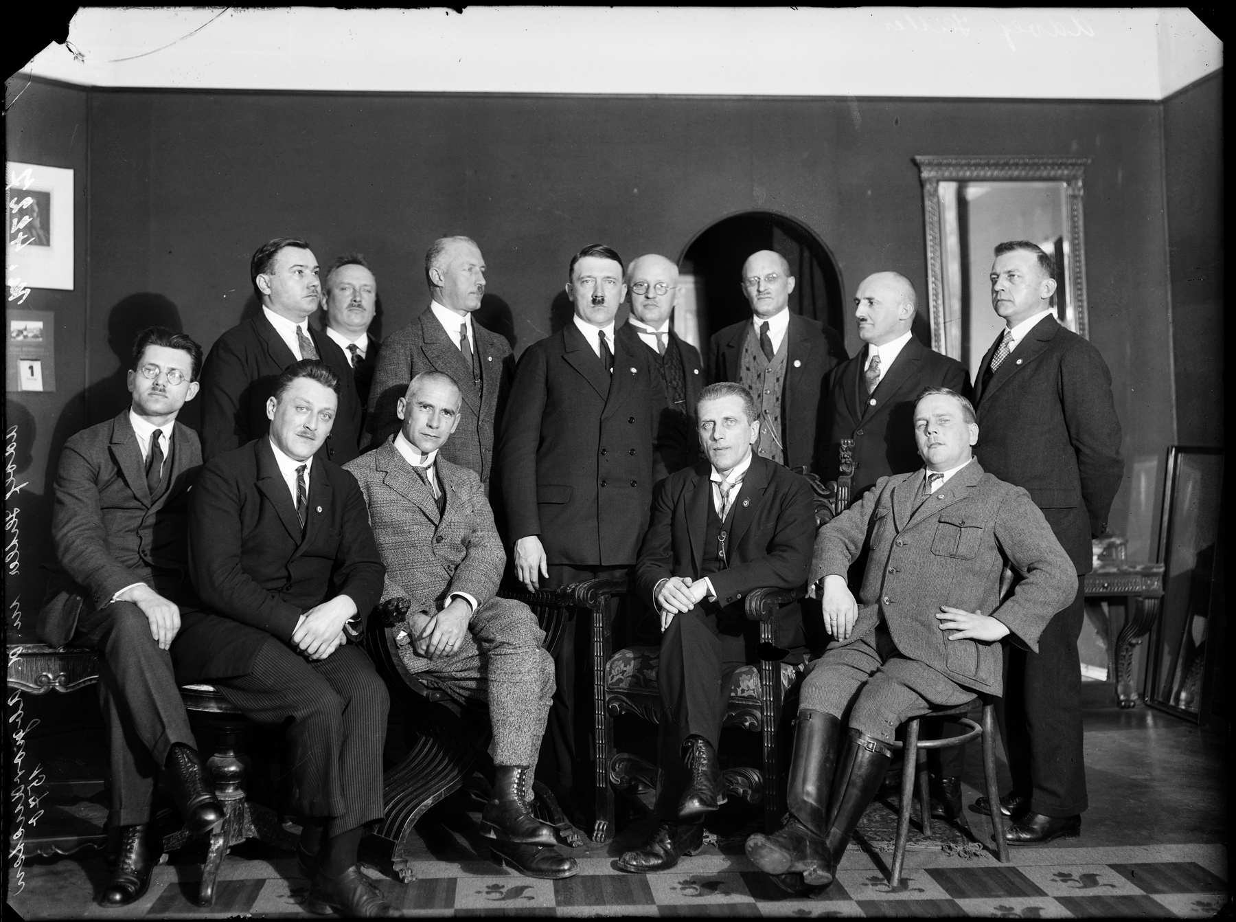 Adolf Hitler and party members pose in Heinrich Hoffmann's studio in Munich (Heinrich Hoffmann photo)