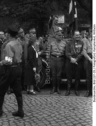 Adolf Hitler salutes the parade of the SA in Bad Harzburg