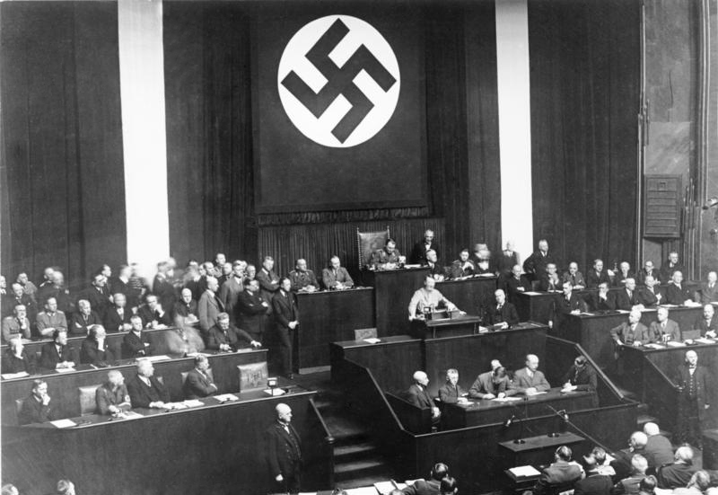 Adolf Hitler declares the Enabling Act at the Reichstag Kroll Opera House, Berlin. The amendment gave him full power to enact laws without the Reichstag, and was the first step to a dictatorship in Germany