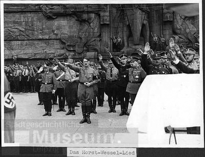 Adolf Hitler in front of Leipzig's Völkerschlachtdenkmal (Monument to the Battle of the Nations) during the Horst Wessel Lied (anthem of the NSDAP)