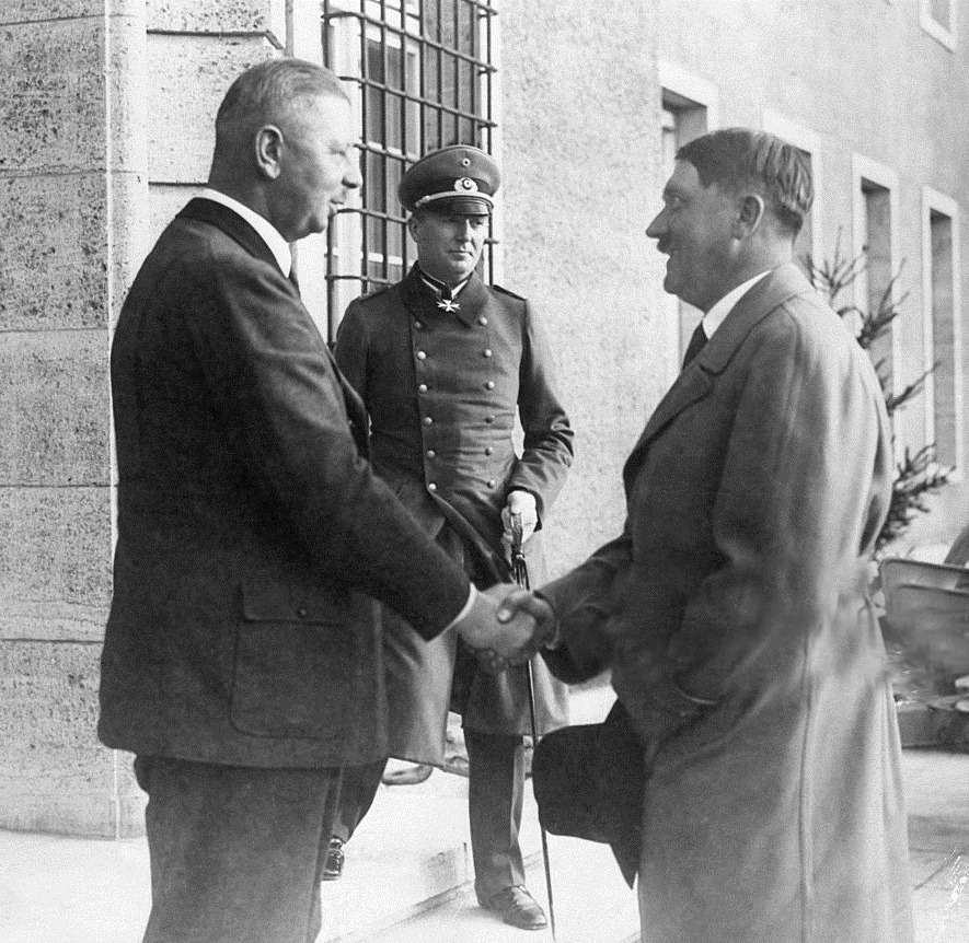 Adolf Hitler is greeted by Hindenburg's son Major Oscar Von Hindenburg and the President's Military adjutant, Captain Von Schulenburg in neudeck for the President's 86th birthday