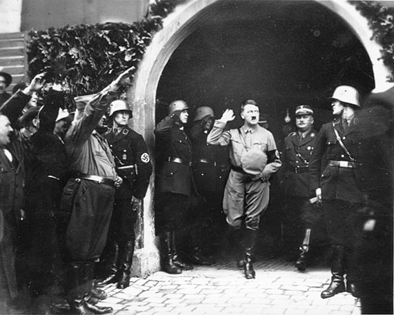 Adolf Hitler leaves Kelheim's city hall after a speech for the Reichstag election campaign
