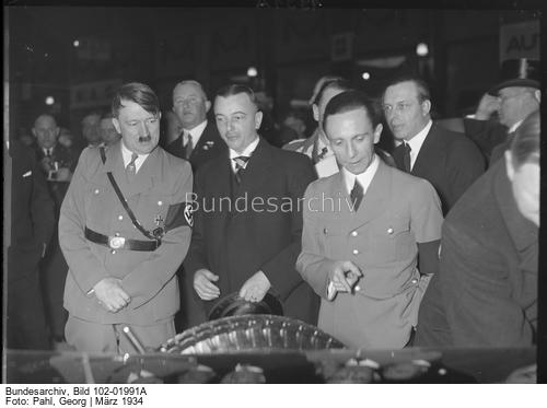Adolf Hitler, Josef Goebbels, and Wilhelm Kissel at the Berlin auto show