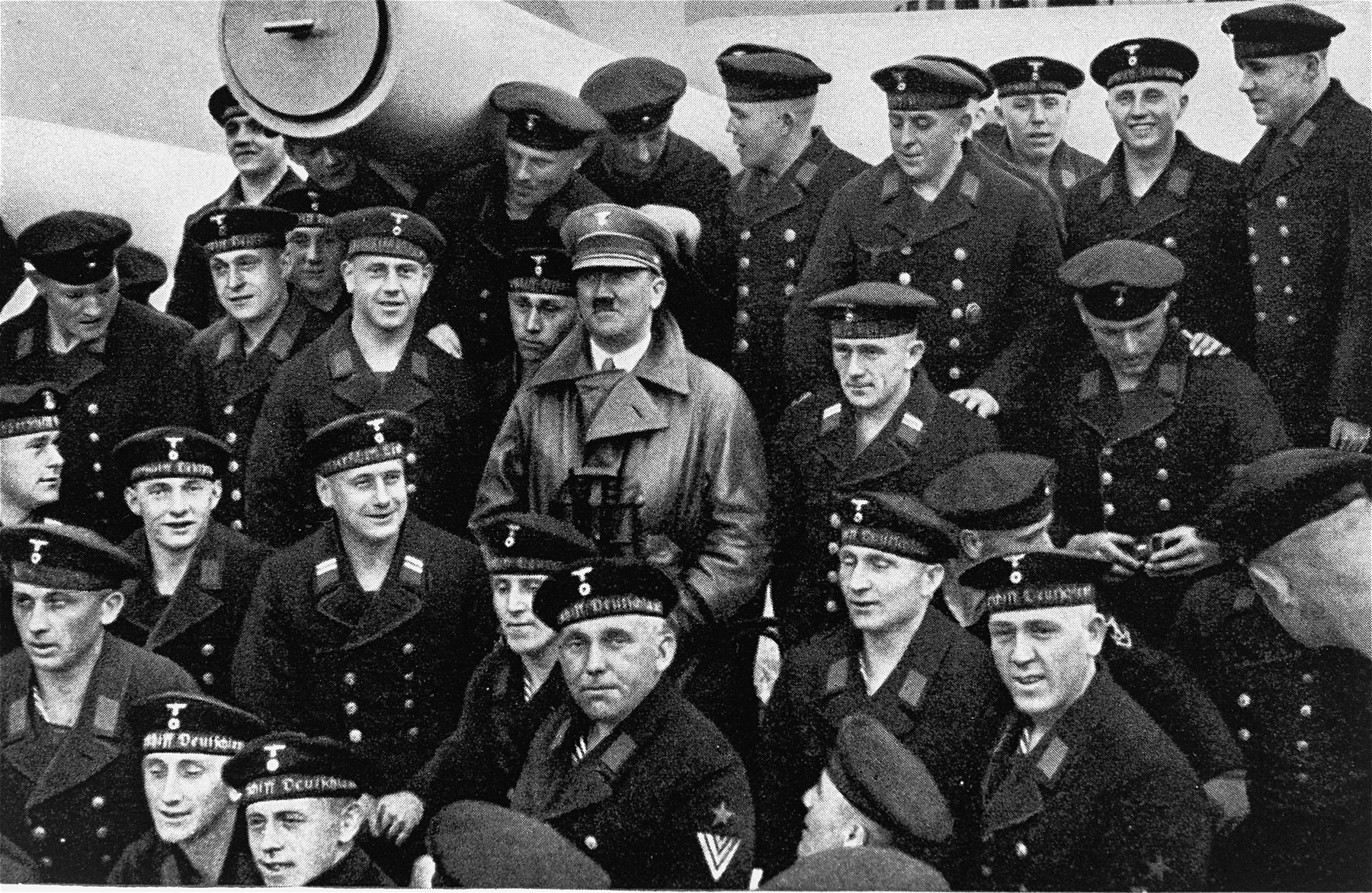 Adolf Hitler poses with a group of sailors aboard the Deutschland battleship