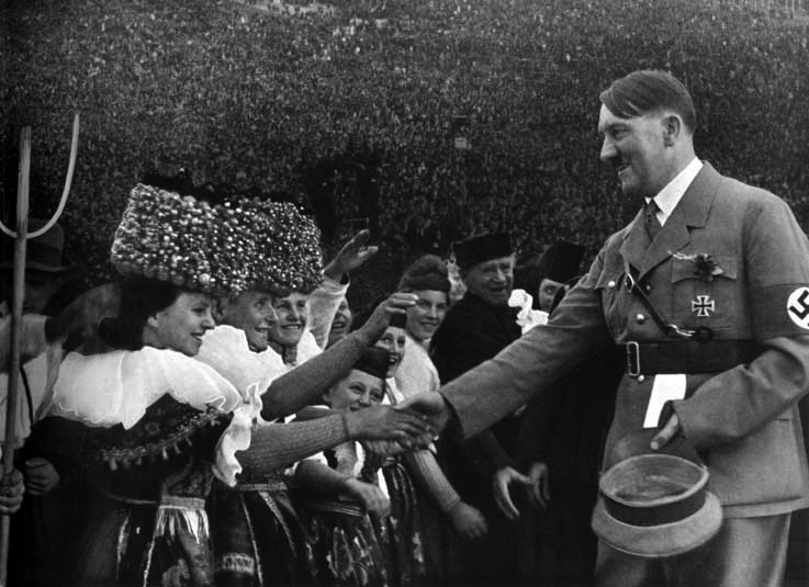 Adolf Hitler greets some women at the Erntedankfest on the Bückeberg