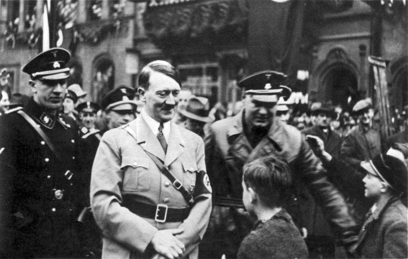 Adolf Hitler in Saarbrücken Saarland is welcomed by a young boy