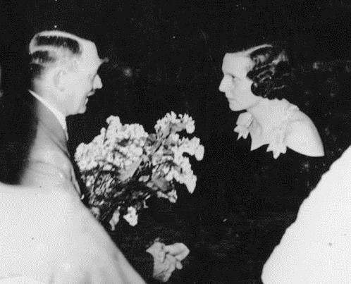 Adolf Hitler congratulates Leni Riefenstahl at the premier of the movie Triumph of the Will