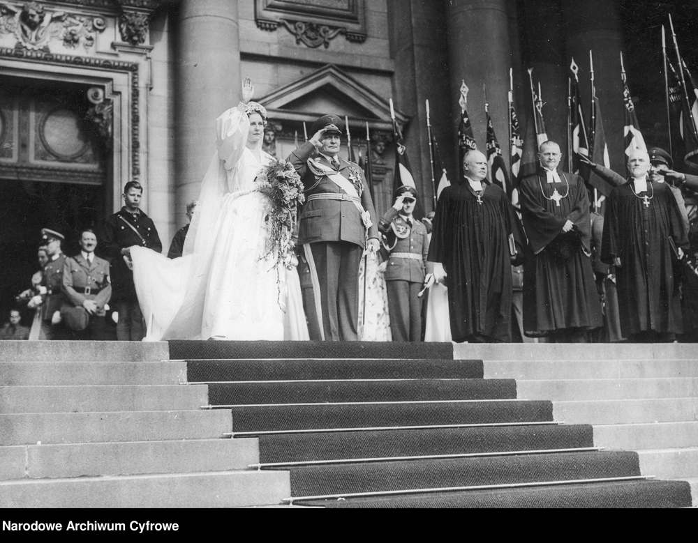 Hermann and Emmy Göring leave the Berlin cathedral after their wedding, followed by their witness Adolf Hitler