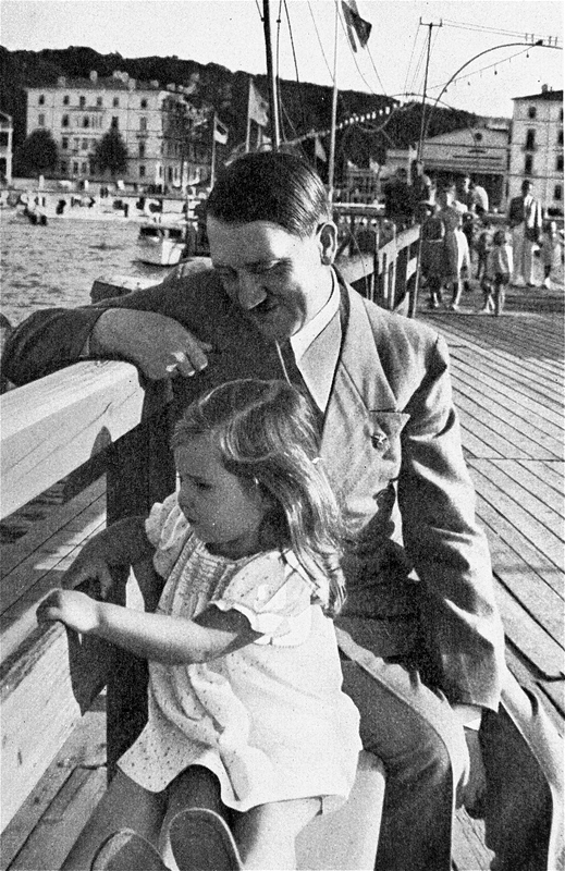 Adolf Hitler with Helga Goebbels during a walk on Heiligendamm beach