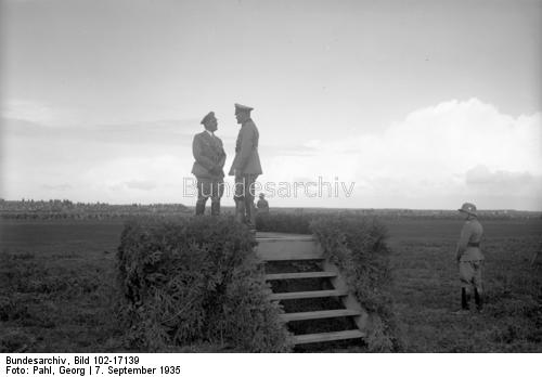 Adolf Hitler with Werner von Blomberg at the army maneuvers at the Munster training camp