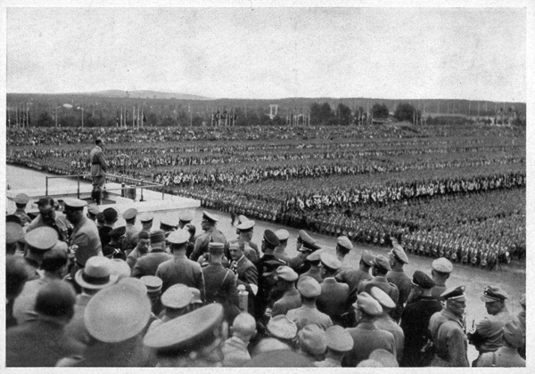 Adolf Hitler at the Zeppelinfeld tribune gives his speech to the call of the Politischen Leiter in Nuremberg before 100.000 participants