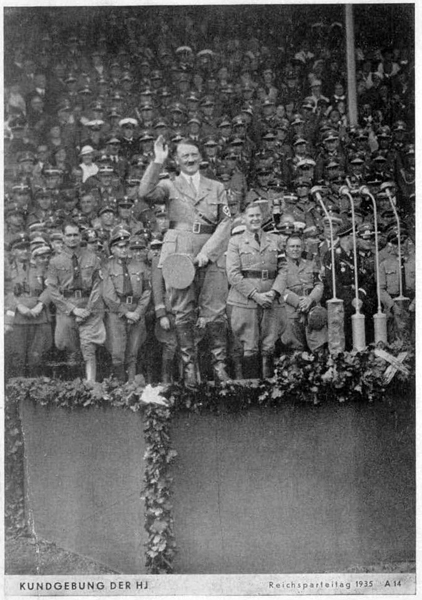 Adolf Hitler salutes the crowd of HJ before his speech at the Reichsparteitag
