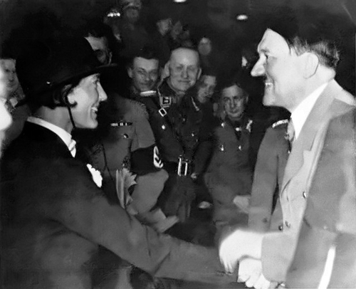 Adolf Hitler greets horse rider Irmgard Georgius during a riding show in Berlin