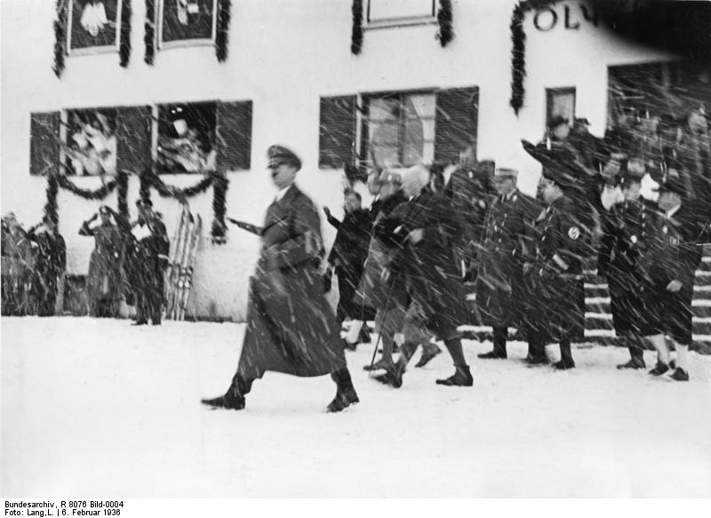Adolf Hitler leaves for the train station after the opening of the Winter Olympics in Garmisch-Partenkirchen