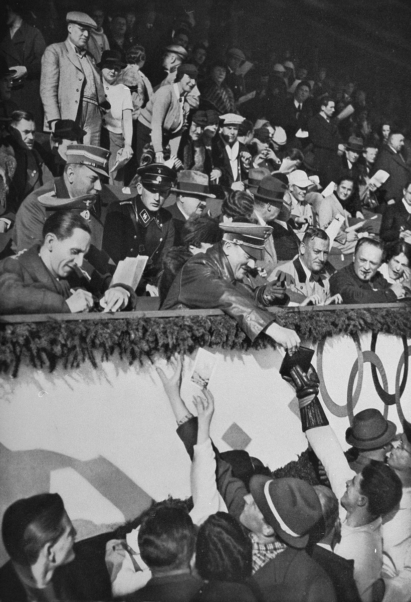 Adolf Hitler and Joseph Goebbels sign autographs on the occasion of the Hockey match between Canada and United States at the Winter Olympics