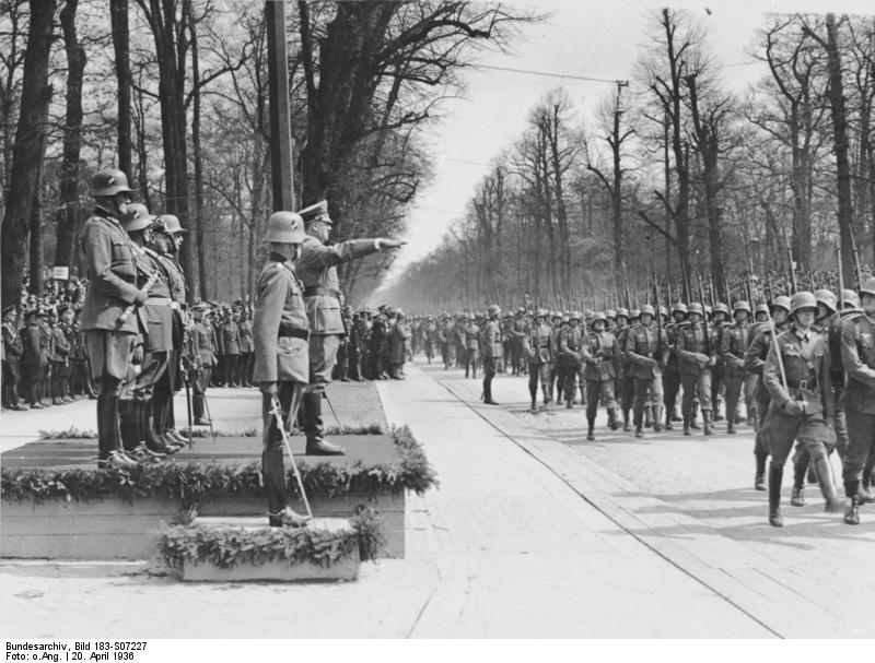 Adolf Hitler reviewing a military parade held in celebration of his 47th birthday