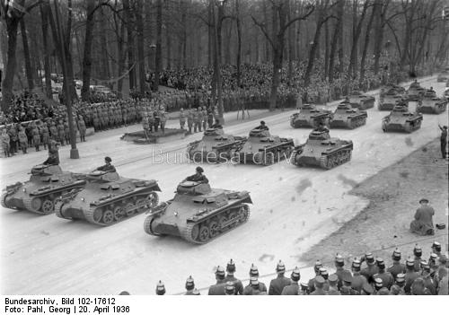 Adolf Hitler saluting a parade of Panzer I tanks in front of the Technical University in Berlin on the occasion of his birthday