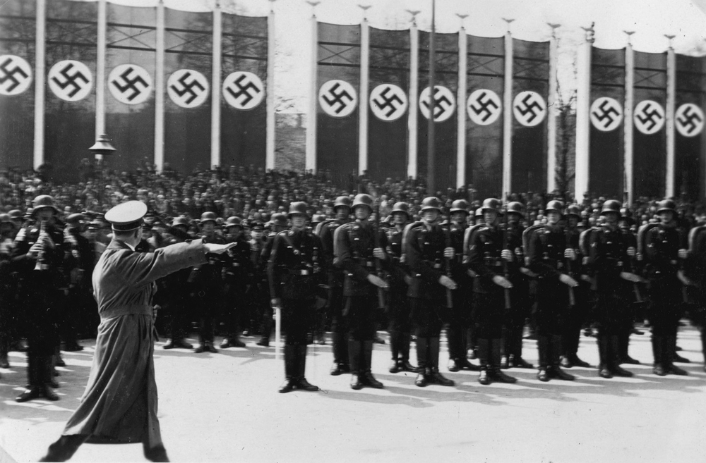 Adolf Hitler salutes his honor guard in Berlin's Lustgarden during the May Day celebration