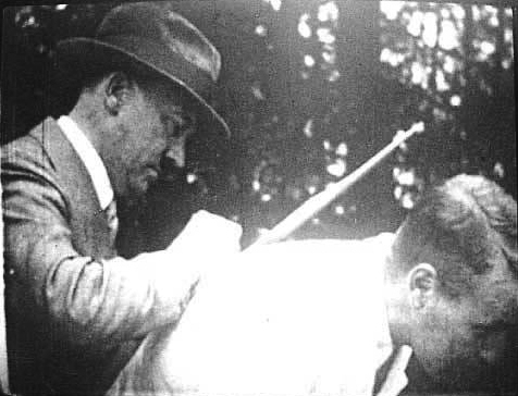 Adolf Hitler signs an autograph on the back Wieland Wagner at the villa Wahnfried in Bayreuth