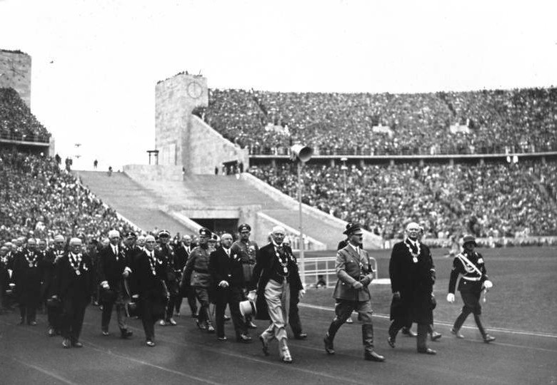 Adolf Hitler leading officials of the International Olympic Committee into the Berlin Olympic Stadium