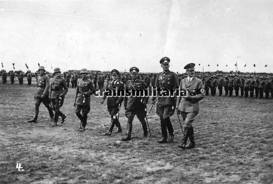 Adolf Hitler, joined by several generals and staff officers, during the parade of the V. Armeekorps in Giebelstadt, near Würzburg