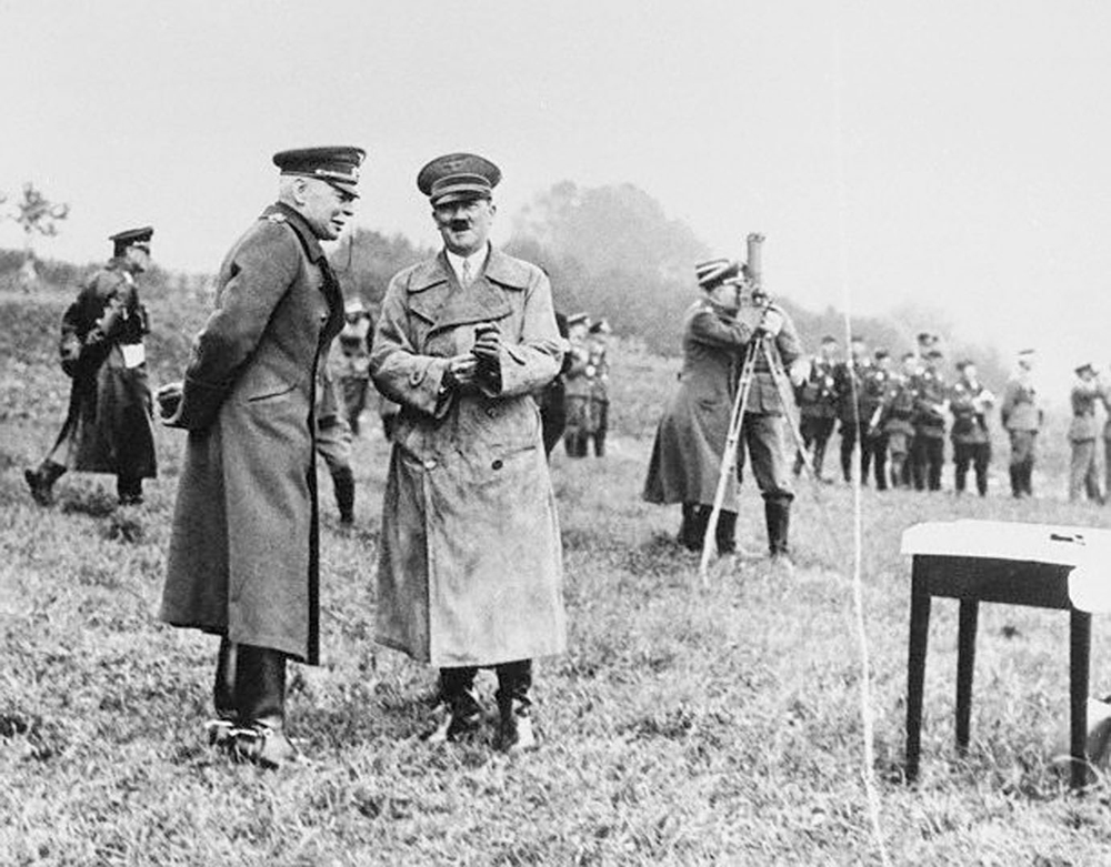 Adolf Hitler in conversation with Hans von Seeckt during a visit of a command post during Wehrmacht maneuvers