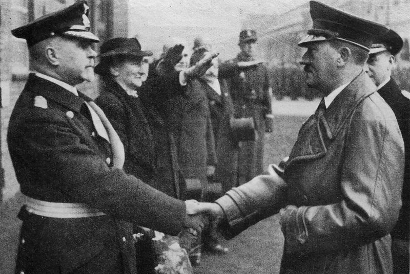 Adolf Hitler greets vice admiral Max Bastian at the launch of the Gneisenau battleship
