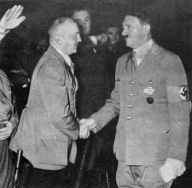 Adolf Hitler greets Gauleiter Wagner at the Christmas party in Loewenbraeukeller