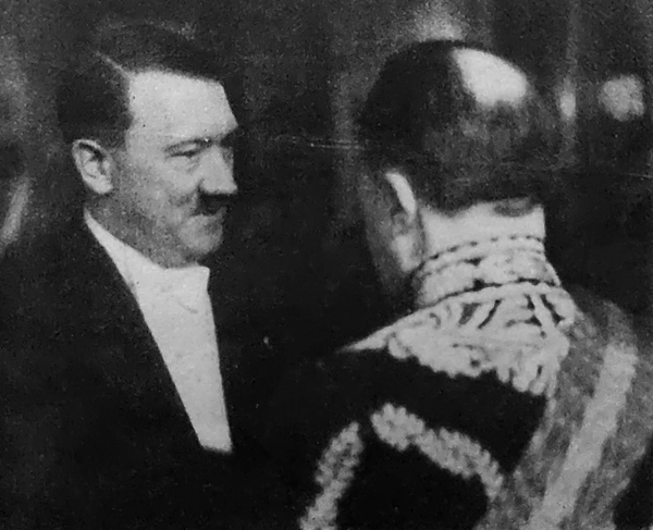 Adolf Hitler in conversation with British diplomat Sir Eric Phipps during the New Year reception in Berlin