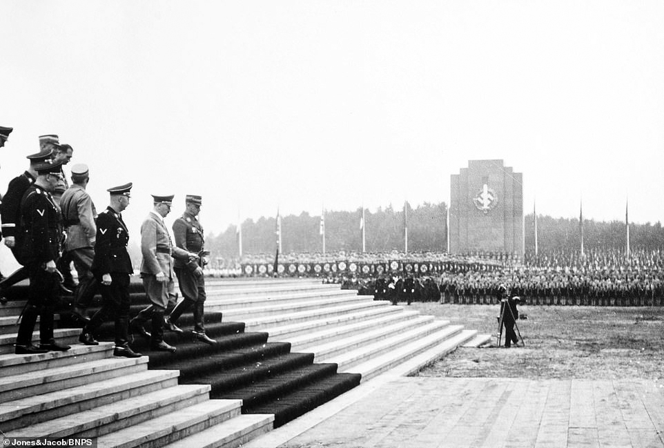 Adolf Hitler arrives to dedicate the foundation stone of the new German Stadium in Nuremberg