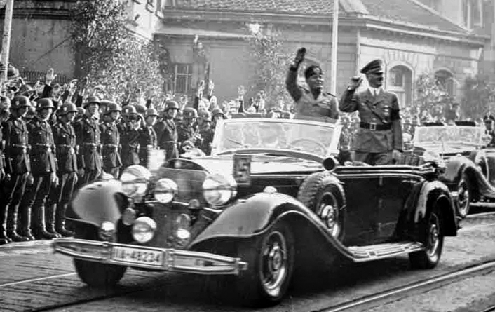 Adolf Hitler and Benito Mussolini drive through Essen