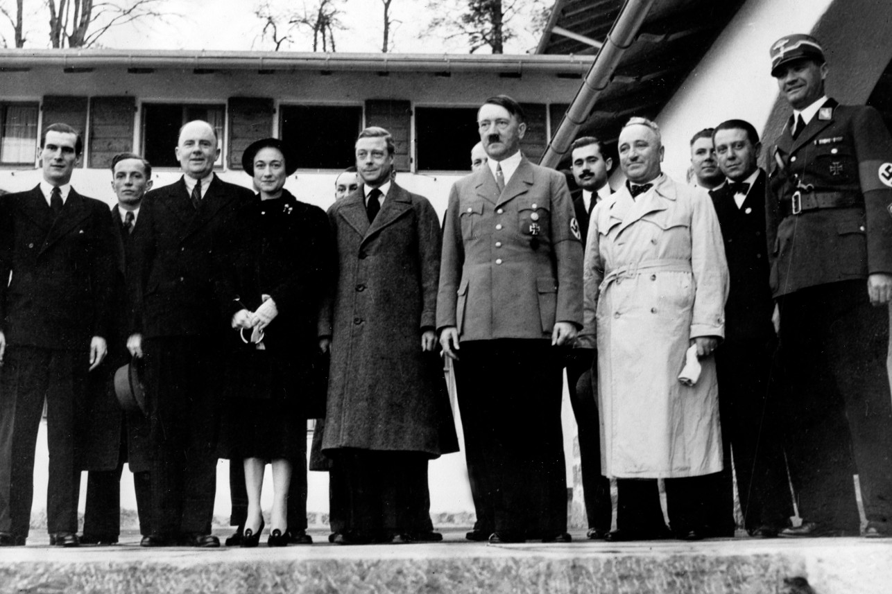 Adolf Hitler with the Duke and Duchess of Windsor pose in front of the stairs of the Berghof