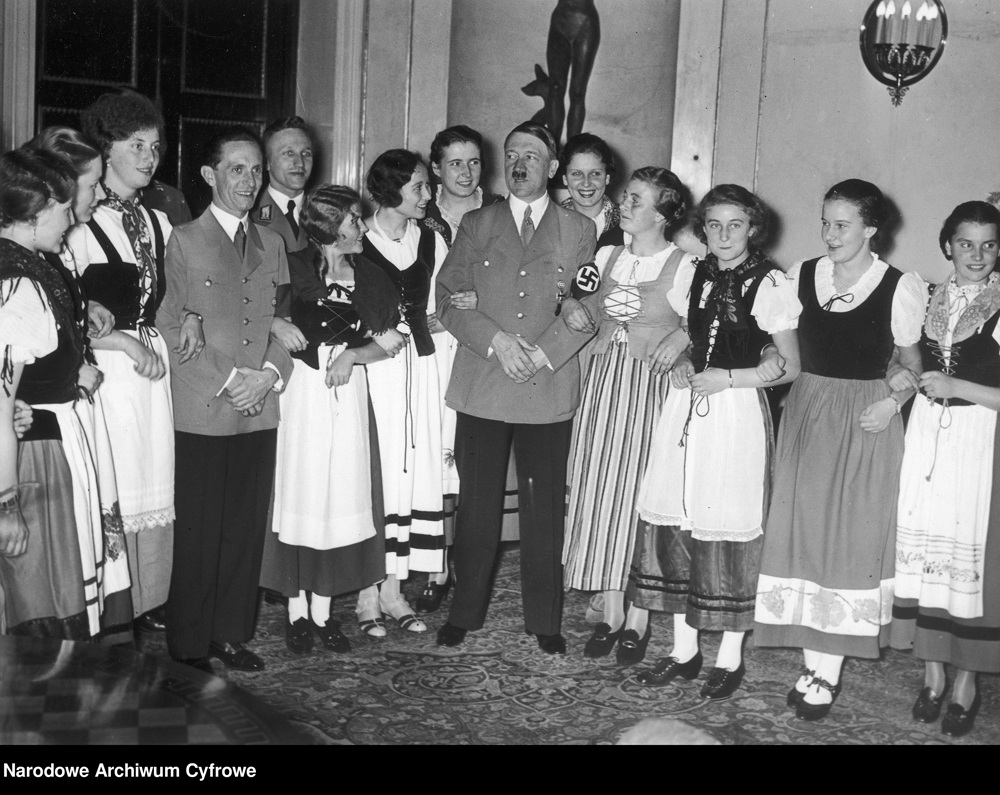 Adolf Hitler and Joseph Goebbels pose with BDM girls on the occasion of Goebbels 40th birthday