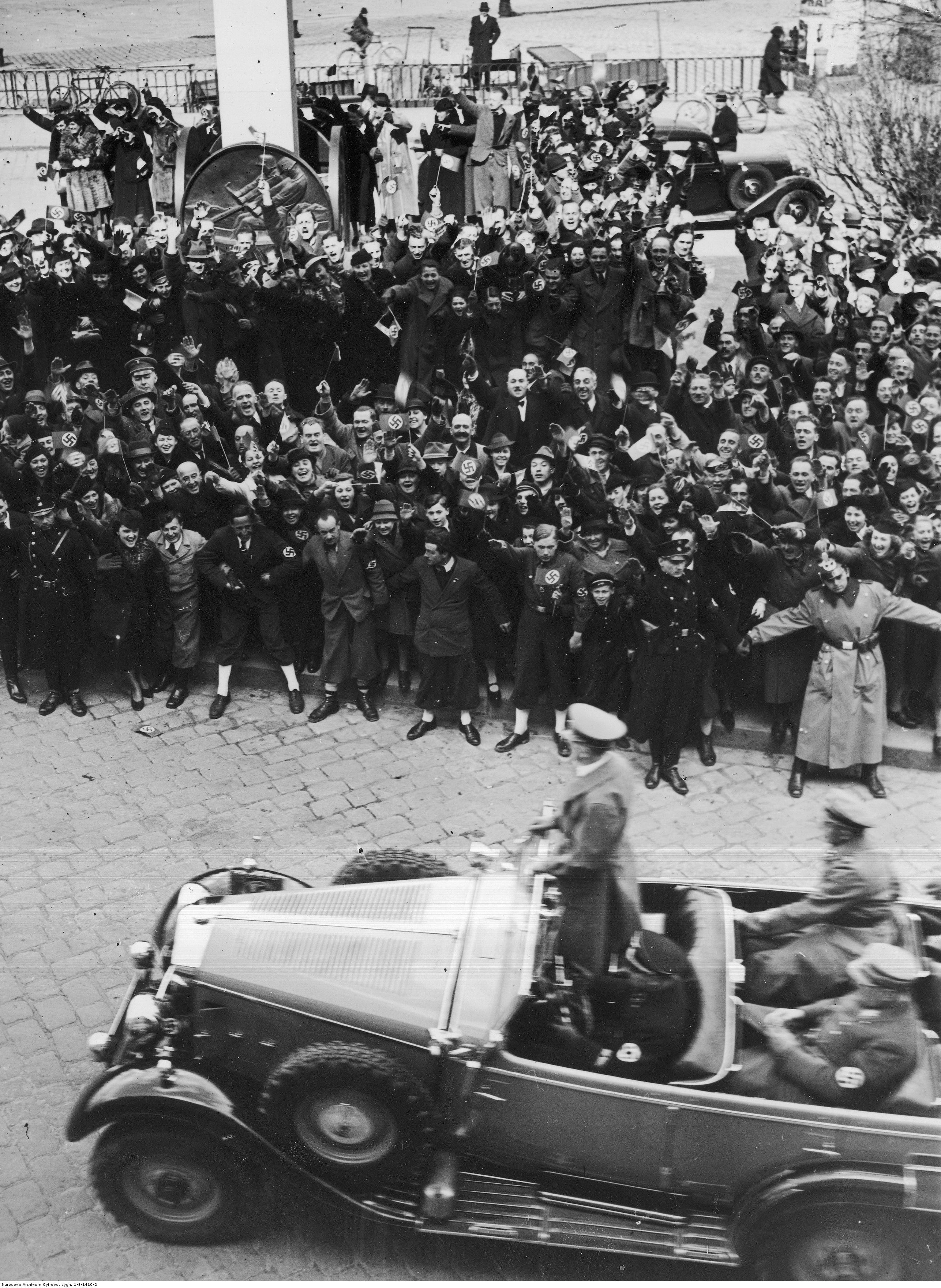 Adolf Hitler is greeted by the crowd as he crosses Linz