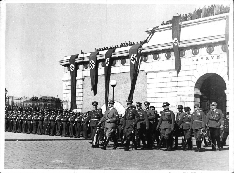 Adolf Hitler in front of Vienna's Burgtor