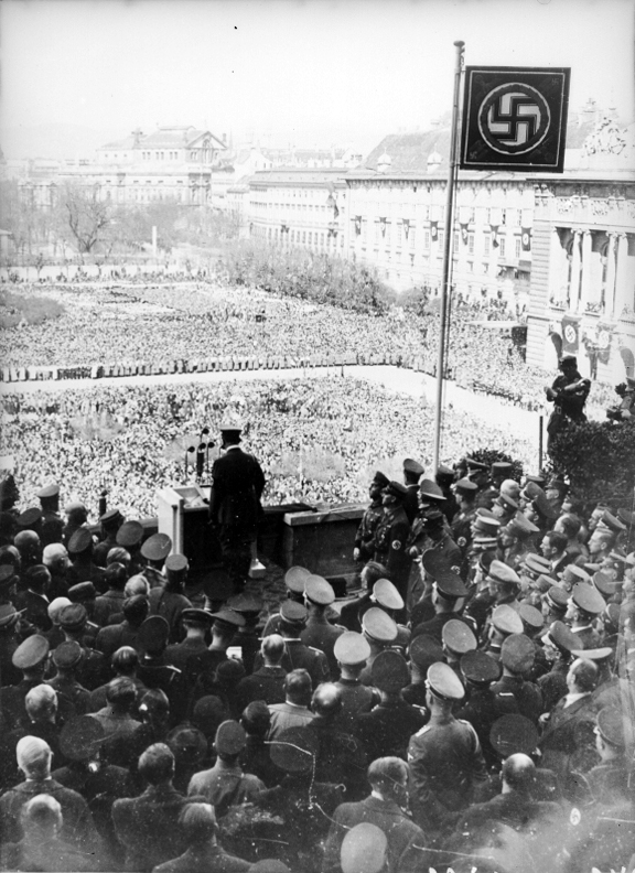 Adolf Hitler at the balcony of the Hofburg on the  Heldenplatz in Wien giving a speech after the Anschluss
