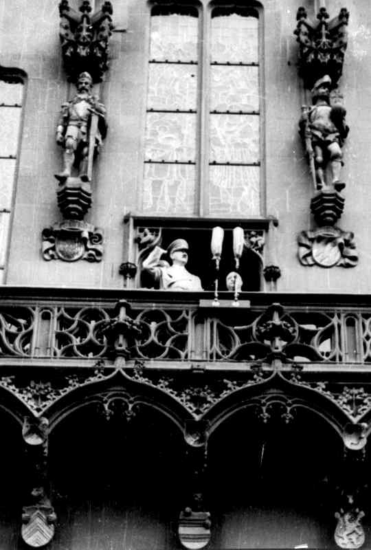 Adolf Hitler salutes from the balcony of Frankfurt's town hall