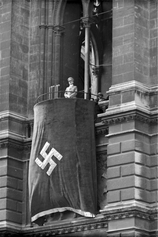 Adolf Hitler makes a speech from the balcony of Vienna's Rathaus