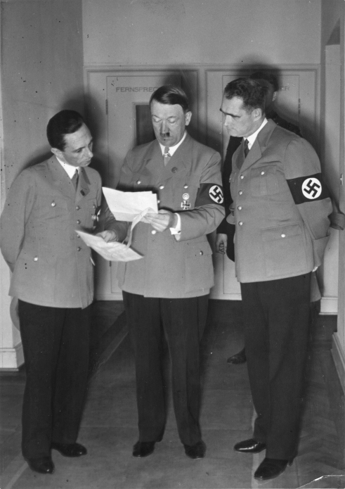 Adolf Hitler reviews the results of the plebiscite for Austria with Joseph Goebbels and Rudolf Hess