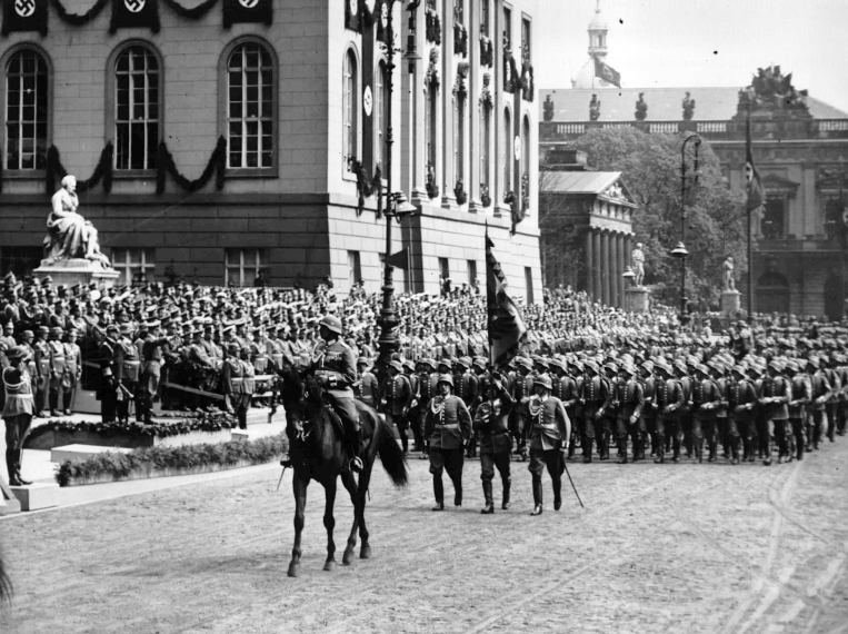 Adolf Hitler salutes the parade for his birthday