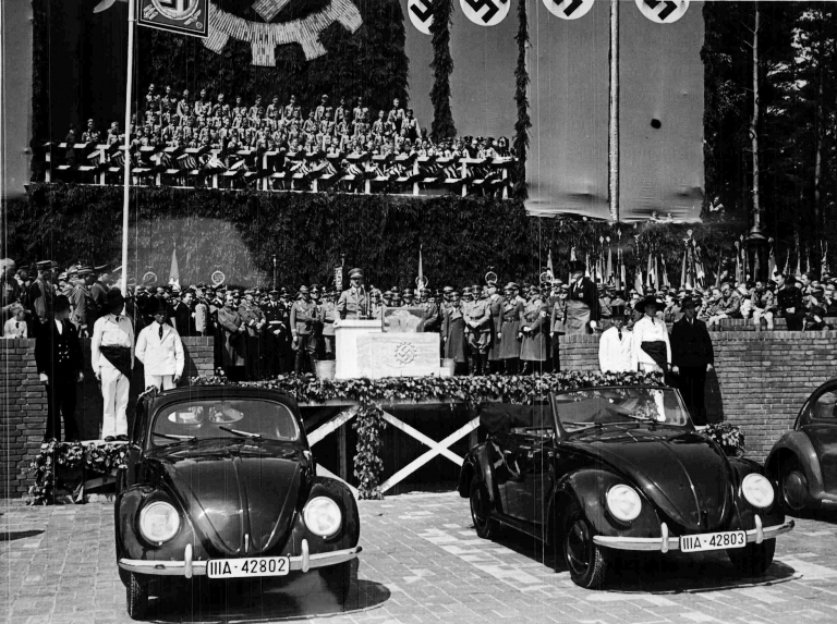Adolf Hitler makes a speech at the presentation of the beetle