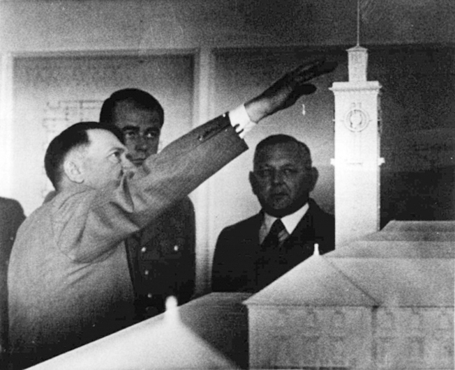Adolf Hitler in Bayreuth's Sieberthalle inspects a model of a new building for the city