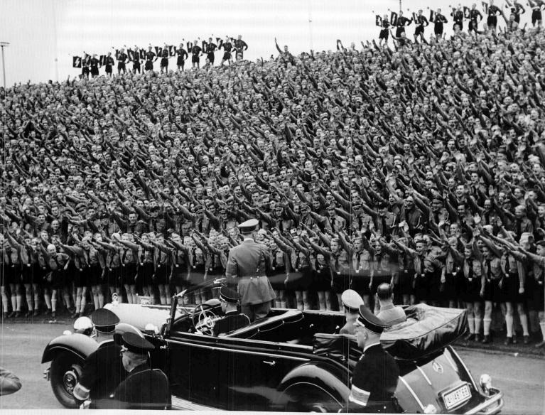 Adolf Hitler arrives in Nuremberg's stadium before his speech to the Hitler Jugend