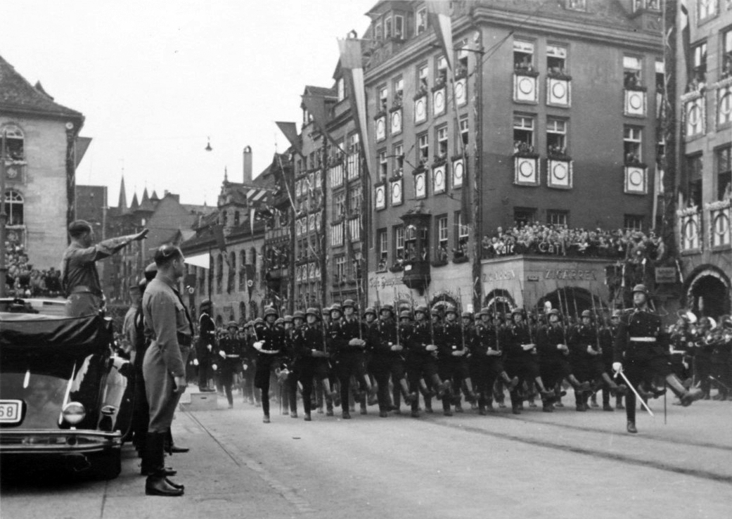 Adolf Hitler salutes the parade of the SA in the streets of Nuremberg on the occasion of the Reichsparteitag