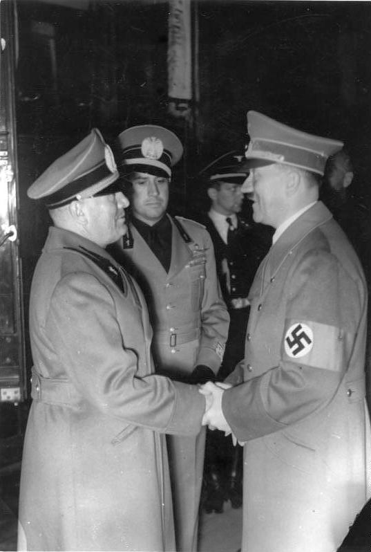 Adolf Hitler greets Benito Mussolini and Galeazzo Ciano in Munich's station at their arrival before the Munich conference