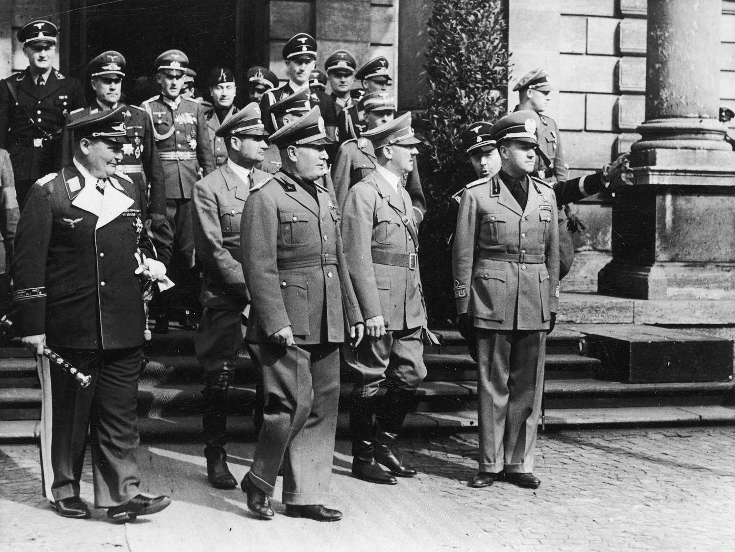Adolf Hitler leaves Munich's station with Mussolini, Ciano and his staff before the Munich conference