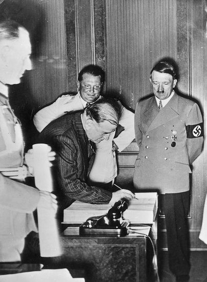 Adolf Hitler with the French prime minister Edouard Daladier signing the Munich agreement after the negotiations